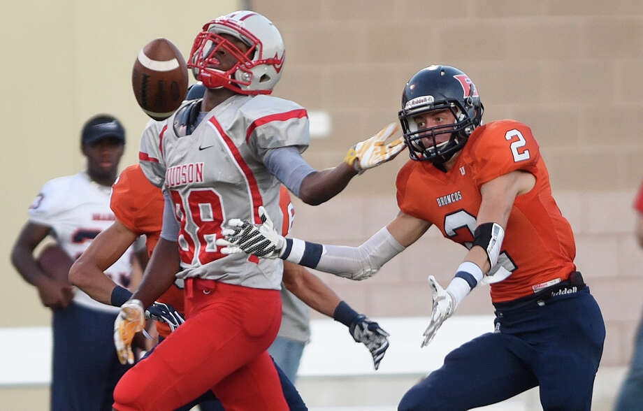 Receiver Brycen Coleman of Judson is unable to hang to a pass as James Olsen of Brandeis gives chase during high school football action at Farris Stadium on Thursday, Sept. 3, 2015. Photo: Billy Calzada, Staff / San Antonio Express-News / San Antonio Express-News
