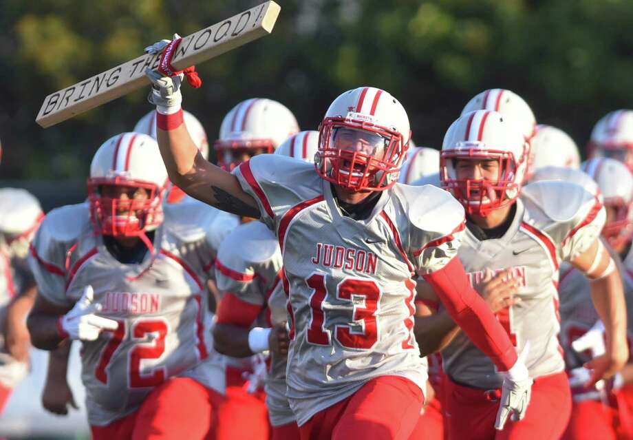 Judson senior running back Michael Maloto (13) shouts encouragement as he and teammates take the field against Brandeis at Farris Stadium on Thursday, Sept. 3, 2015. Photo: Billy Calzada, Staff / San Antonio Express-News / San Antonio Express-News