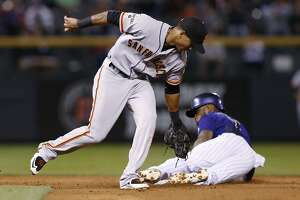 Rockies deal Giants 6th straight loss, 11-3 - Photo