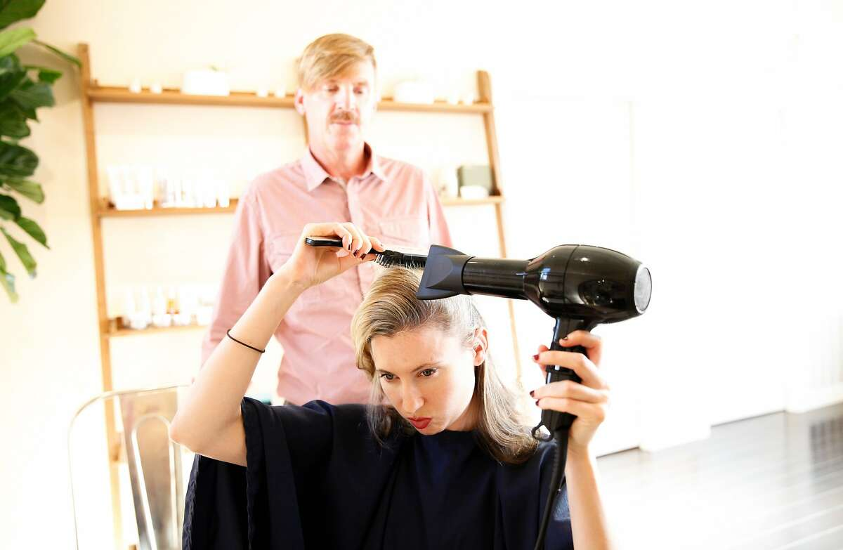 Hairstylist Bradley Crane gives a blowdry tutorial to Lisa McNabb at Ayla in San Francisco, Calif., on Thursday, September 3, 2015.