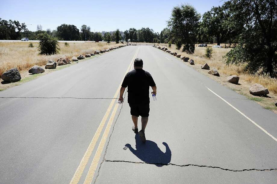 Tribal Administrator of the Koi Nation, Dino Beltran walks down a road at the Anderson Marsh State Historic Park in Lower Lake, CA Tuesday, September 1, 2015. The Clear Lake area is rich with prehistoric Native American archeological sites that are increasingly becoming targets for looters searching for artifacts to sell for quick cash. Photo: Michael Short, Special To The Chronicle