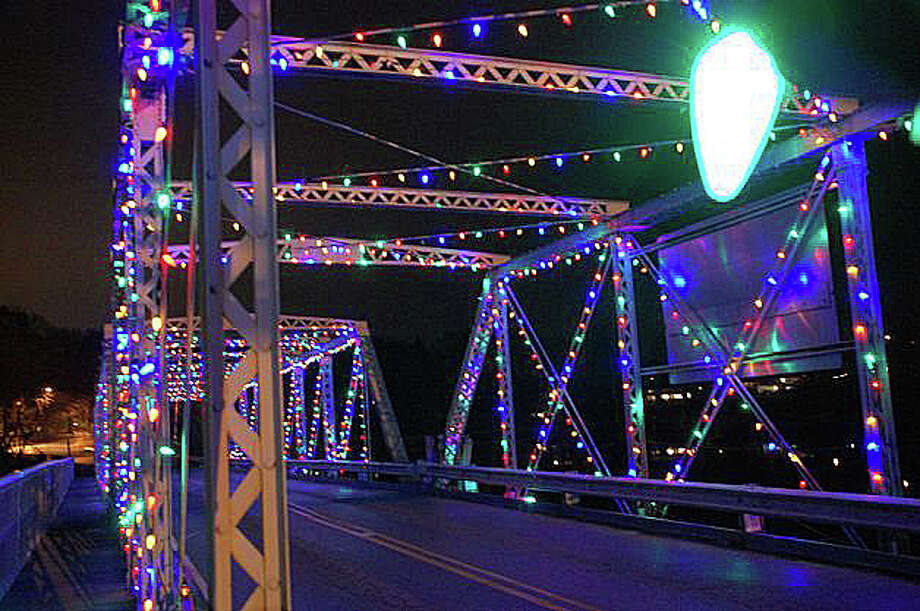 "Though holiday lights may dress up the Bridge Street bridge, columnist Dan Woog writes there appears to be a consensus to fix the ""crumbling"" span. ""Actually, it's the William F. Cribari Bridge. The name honors the longtime and very theatrical traffic cop who did what he could to untangle the vehicular mess right there. But don't mess with the bridge itself."" Photo: File Photo / Westport News"