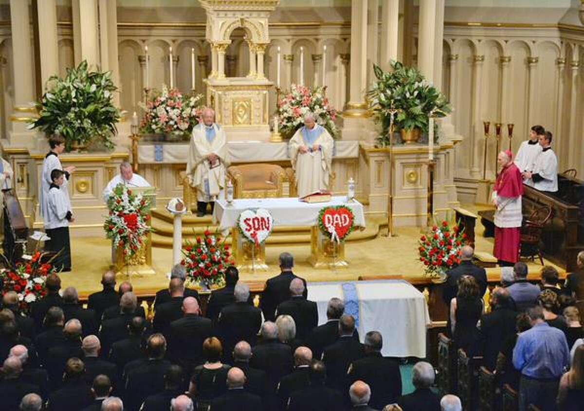 Mourners at the funeral of retired Albany Fire Chief Robert Forezzi Sr. at Historic St. Mary's Church in Albany on Friday, Sept. 4, 2015. (John Carl D'Annibale/Times Union)