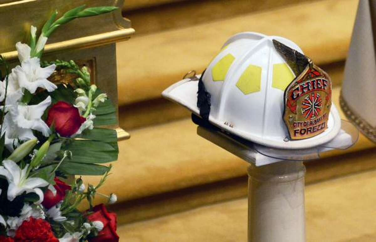 The helmet of retired Albany Fire Chief Robert Forezzi Sr. during his funeral at Historic St. Mary's Church in Albany on Friday, Sept. 4, 2015. (John Carl D'Annibale/Times Union)