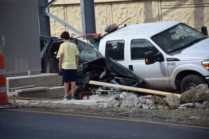 Two construction workers injured in wreck - Photo