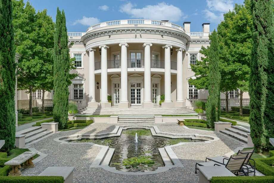 Located in Dallas' affluent Preston Hollow district, this 16,041-square-foot home is on the market for $15 million. Features include European-styled chandeliers and fireplaces, outdoor water fountains, two galleries, a wine cellar and a six-car garage big enough for two limousines, according to Zillow. Photo: Jason Anderson, Courtesy,  Zillow / JA2 Photo