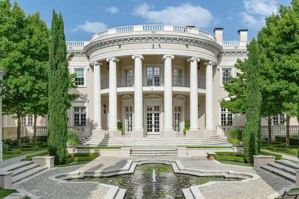 Located in Dallas' affluent Preston Hollow district, this 16,041-square-foot home is on the market for $17.9 million. Features include European-styled chandeliers and fireplaces, outdoor water fountains, two galleries, a wine cellar and a six-car garage big enough for two limousines, according to  Zillow .