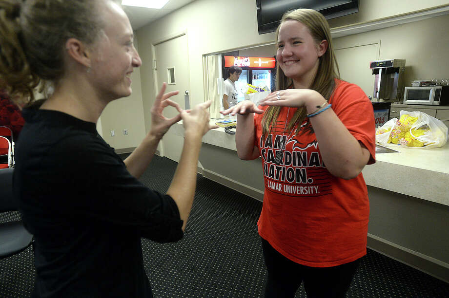 Allie Hayes (right), a junior at Lamar University majoring in the teaching track of American Sign Language (ASL), talks with Jessica Romine, who acts as a student interpreter at Beaumont's Campus Church Wednesday services. The weekly group meets at the Montagne Center, offering worship time for those who are hearing - impaired as well as others studying ASL. Allie was born profoundly deaf, and received her first cochlear implant when she was 20-months-old. At 13, she chose to get a second implant, and though it significantly aids in her ability to hear, says there are still challenges. 