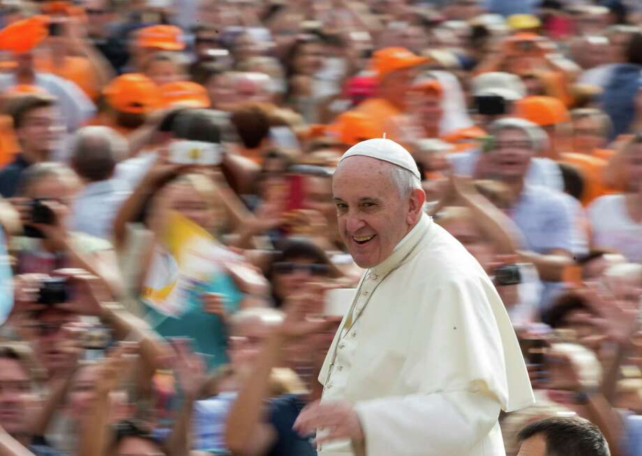 Pope Francis waves to faithful as he arrives for his weekly general audience in St. Peter's Square at the Vatican, National Catholic Educational Association. Photo: Alessandra Tarantino / Associated Press / Associated Press
