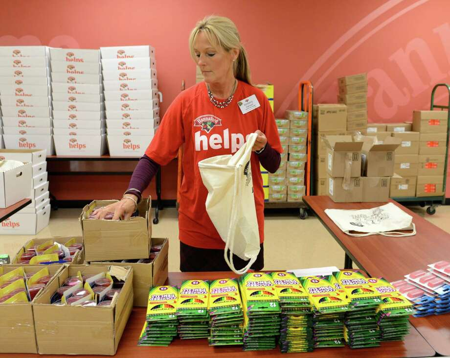 Kimerbly Hanson, assistant store manager at Hannaford Supermarkets, helps to assembly school supplies donated by Hannaford to Capital Region schools Friday, Sept. 4, 2015, at Hannaford Central Ave. in Colonie, N.Y. Hannaford Supermarkets announced a $115,000 donation to support Capital Region children's programs and schools. $80,000 was donated to support eight Capital Region summer camps and youth development programs. $35,000 is to be used for school supplies and snacks for area schools. (Will Waldron/Times Union) Photo: Will Waldron / 00033233A