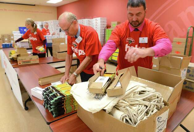 Dennis Martin and Pete Warner, right, of Hannaford Supermarkets help to assembly school supplies donated by Hannaford Supermarkets to Capital Region schools Friday, Sept. 4, 2015, at Hannaford Central Ave. in Colonie, N.Y. Hannaford Supermarkets announced a $115,000 donation to support Capital Region children's programs and schools. $80,000 was donated to support eight Capital Region summer camps and youth development programs. $35,000 is to be used for school supplies and snacks for area schools. (Will Waldron/Times Union) Photo: Will Waldron / 00033233A