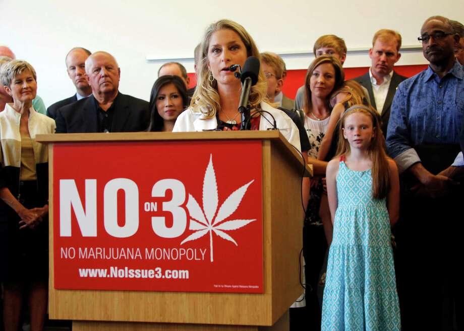 Dr. Sarah Denny, Attending Pediatric Physician at Nationwide Children's Hospital, speaks during a coalition opposing ResponsibleOhio's proposed Constitutional amendment to create a marijuana monopoly at the Nationwide Children's Hospital Research Institute Building on Monday, Aug. 17, 2015, in Columbus, Ohio. Passage of the proposed amendment on Nov. 3 would make Ohio a rare state to go from entirely outlawing marijuana to allowing it for all uses in a single vote. (Tom Dodge/The Columbus Dispatch via AP) MANDATORY CREDIT ORG XMIT: OHCOL101 Photo: Tom Dodge / The Columbus Dispatch