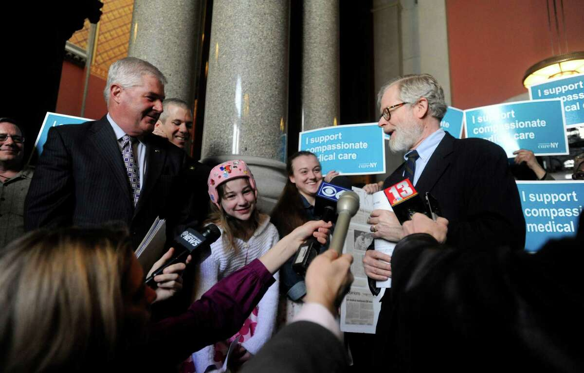New York Assemblyman Richard Gottfried, D-Manhattan, right, speaks at a news conference held by advocates of emergency access to medical marijuana at the Capitol in Albany, N.Y., on Tuesday, April 28, 2015. With Gottfried are Assembly Minority Leader Brian Kolb, R-Geneva, left, Mackenzie Kulawy, 12, second from left, and her sister Kaitlyn Kulawy, 14, of Utica. Patients who urged lawmakers to create a medical marijuana program in New York are now calling for emergency access to the drug now, since the regulations governing the distribution of medical cannabis are likely a year away. They blame Gov. Andrew Cuomo for not taking steps to expedite access for children with debilitating neurological conditions. (AP Photo/Tim Roske) ORG XMIT: NYTR102