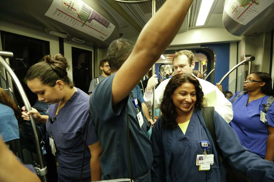 Early morning commuters ride the Metrorail to the Texas Medical Center. Health care remains a bright spot in Houston's economy.   ( Steve Gonzales / Houston Chronicle ) Photo: Steve Gonzales, Staff / © 2015 Houston Chronicle