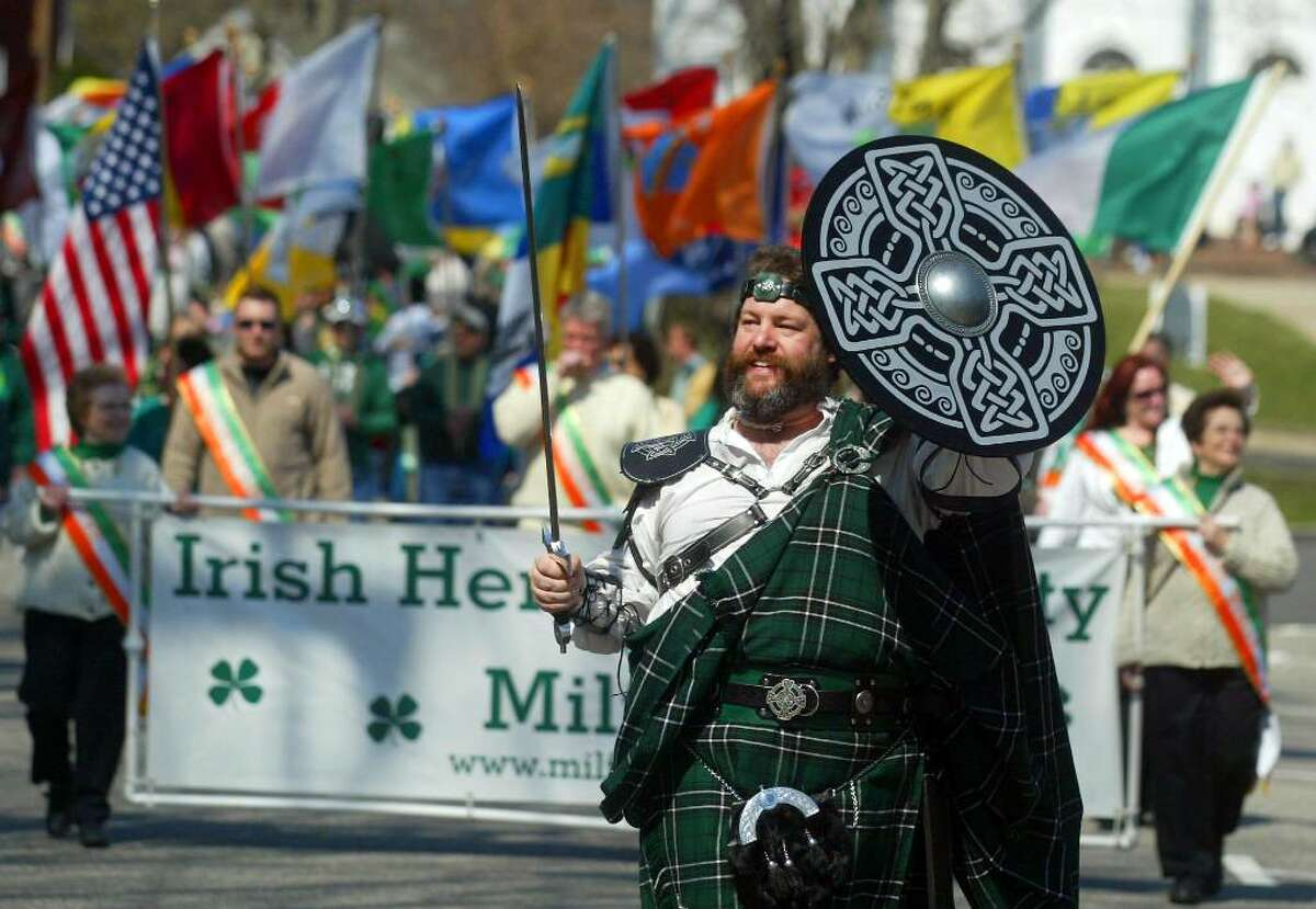 David Conroy raises his sword to salute the St. Patrick's Day Parade crowd, Sunday, March 21, 2010, along the Milford Parade route.