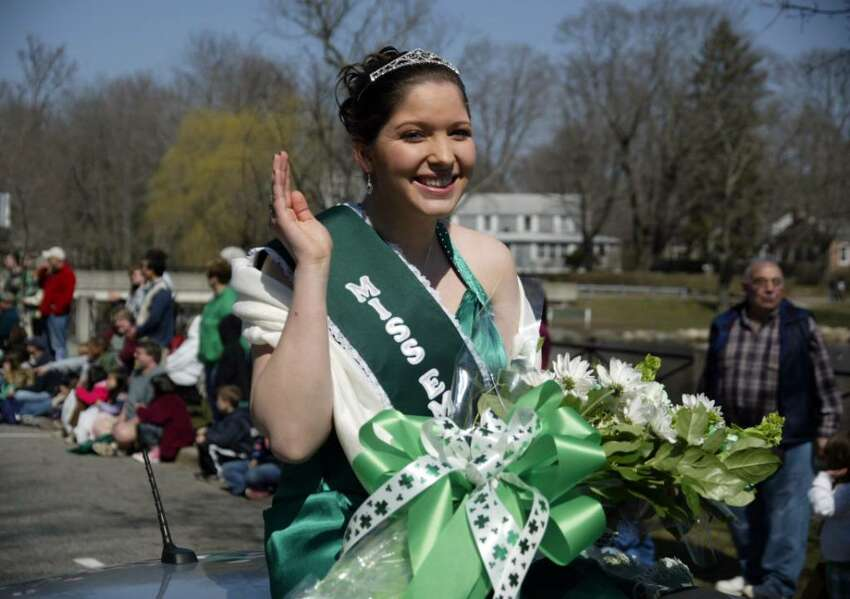 Miss Emerald Isle, Carla Marie Lynch waves to the crowds, Sun., March 21, 2010, as she rides along the Milford St. Patrick's Day Parade route in Milford.