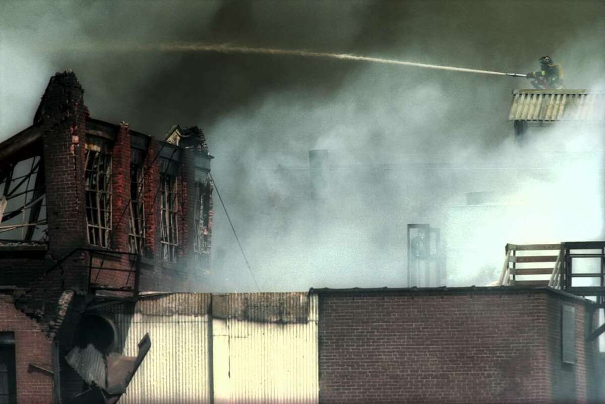 The Latex Foam fire in Ansonia, Conn. on May 14th, 2001. June 26, 2014 Four firefighters are injured as an overnight fire damages the Latex International Foam factory on River Road in Shelton. This blaze comes 11 years after the company's original site in Ansonia burned down (pictured). The company, now known as Talalay Global, was formed by executives from the Sponge Rubber Company, whose downtown Shelton plant was destroyed in 1975, one of several notable acts of arson in the city in the past 50 years.