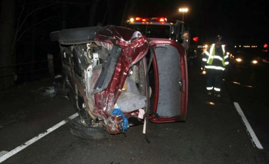 The scene following an early morning accident that shut down the Merritt Parkway between exits 44 and 42 southbound in Fairfield at about 6 am Monday morning. The three car accident resulted in one vehicle rolling over multiple times and catching on fire. The female driver of the car was treated on scene by fire and ambulance personnel and transported to St. Vincent's Hospital. Photo: Contributed Photo / Connecticut Post Contributed