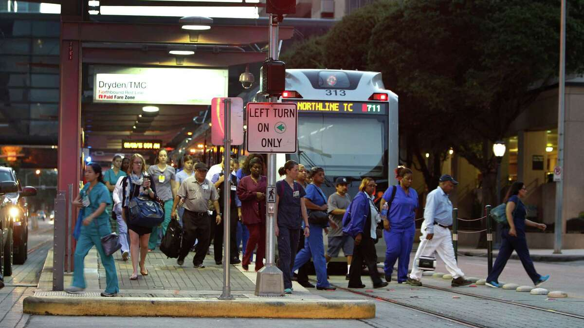 Early morning commuters exit the Metrorail at the Dryden/TMC station in the Texas Medical Center Thursday, Sept. 3, 2015, in Houston. The rapid growth of the medical industry in Houston has helped as a backstop against the wave of lay-offs in oil and gas. ( Steve Gonzales / Houston Chronicle )