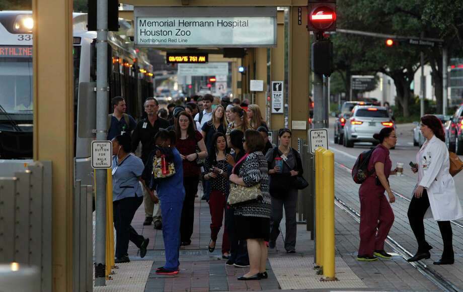 Commuters bustle Sept. 5 at a light rail stop in the Texas Medical Center. Metro is revising plasn to extend rail from the medical center southwest to Missouri City. Photo: Steve Gonzales, Staff / © 2015 Houston Chronicle