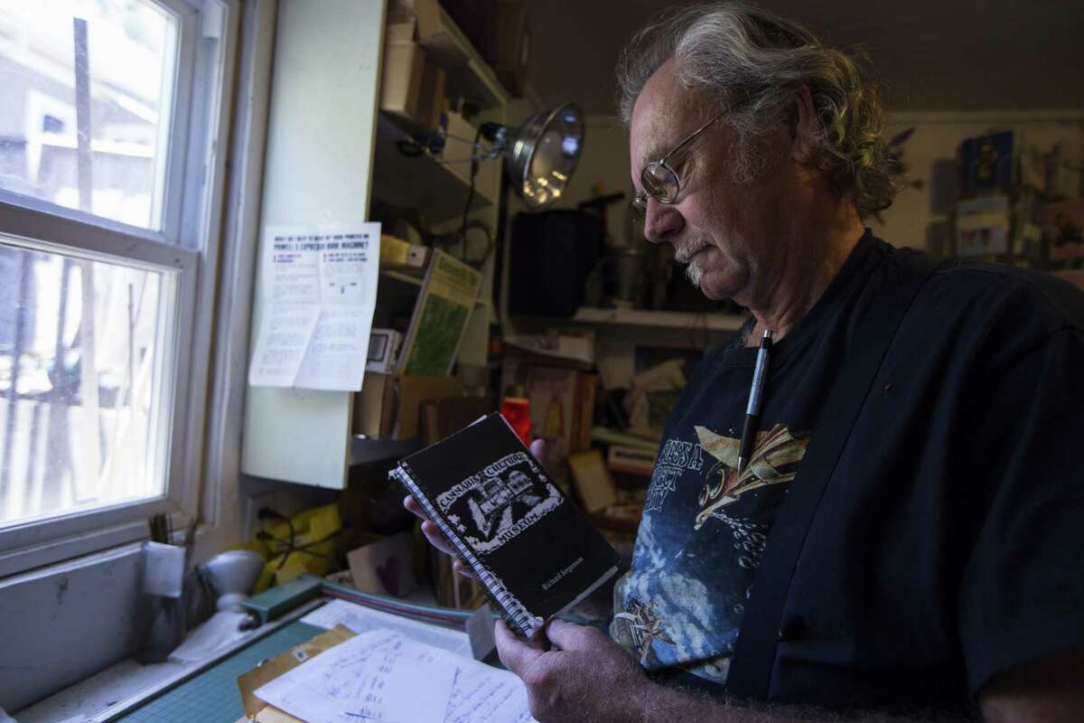 Richard Jergenson holds one of his notebooks detailing his plans to open a cannabis culture museum. Jergensen, a self-described archivist, has collected cannabis-related media and magazines for the past 45 years. (Sean Logan/News21)