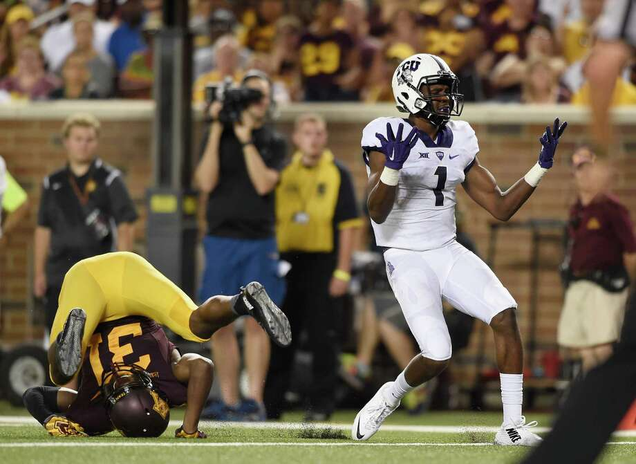 MINNEAPOLIS, MN - SEPTEMBER 3: Emanuel Porter #1 of the TCU Horned Frogs reacts to a missed reception as Eric Murray #31 of the Minnesota Golden Gophers flips over during the fourth quarter of the game on September 3, 2015 at TCF Bank Stadium in Minneapolis, Minnesota. Murray was called on pass interference on the play. TCU Horned Frogs defeated the Minnesota Golden Gophers 23-17. (Photo by Hannah Foslien/Getty Images) Photo: Hannah Foslien, Stringer / Getty Images / 2015 Getty Images