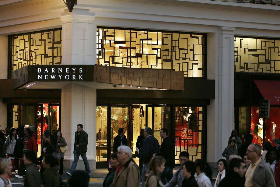 In this file photo, holiday shoppers bustle by the new entrance to Barney's of New York in San Francisco's Union Square Saturday evening.  Photo: Kat Wade, Special To The Chronicle