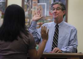 C.W. Nevius is sworn in as a marriage commissioner for a day by Jennifer Wong of the city clerk's office at City Hall in San Francisco, Calif. on Friday, Sept. 4, 2015.