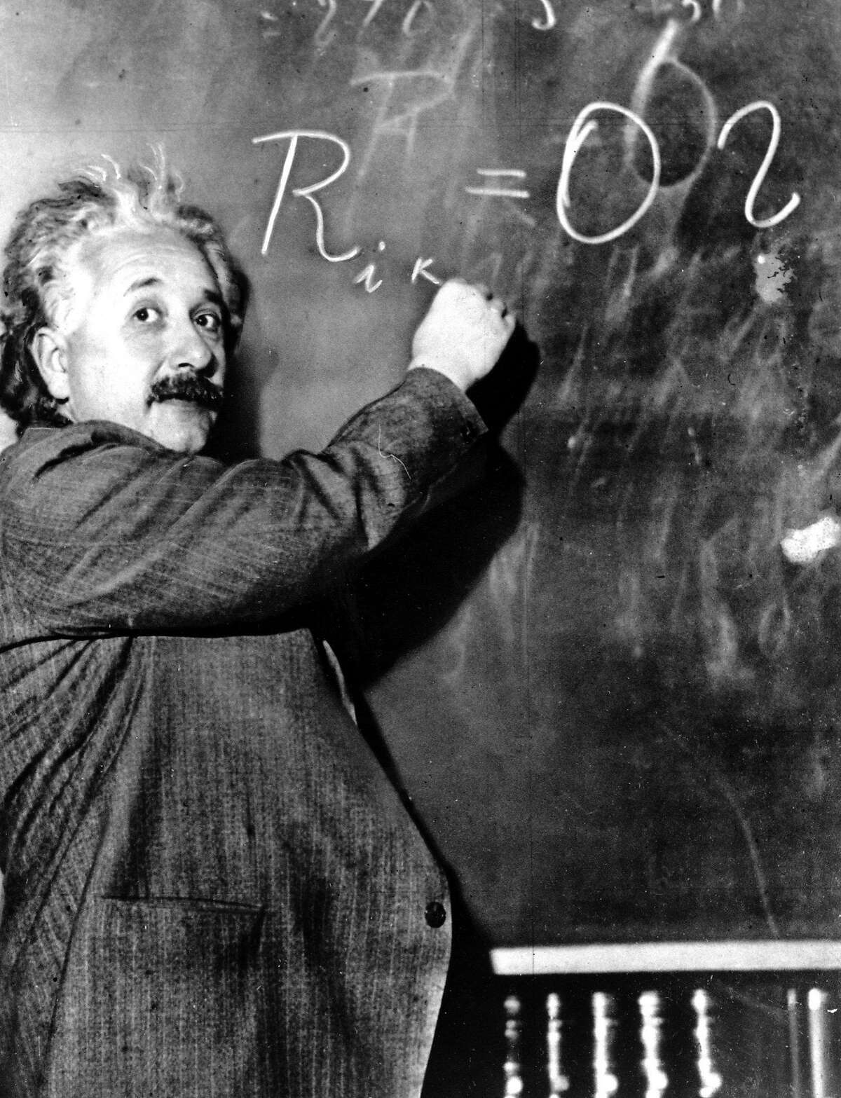 ** ADVANCE FOR SUNDAY, APRIL 17 **FILE**Dr. Albert Einstein writes an equation for the density of the Milky Way on the blackboard at the Carnegie Institute, Mt. Wilson Observatory headquarters in Pasadena, Calif., in this Jan. 14, 1931 file photo. Einstein achieved world reknown in 1905, at age 26, when he expounded a theory of general relativity which proposed the existence of atomic energy. Though his concepts ushered in the atomic age, he was a pacifist who warned against the arms race. He was awarded the Nobel Prize for Physics in 1921. (AP Photo) Ran on: 04-17-2005 Albert Einstein plays his violin at his study in Princeton, above left; writes an equation in Pasadena relating to the density of the universe, center; and begins an Adirondacks vacation by sailing Saranac Lake. Ran on: 07-14-2011 Photo caption Dummy text goes here. Dummy text goes here. Dummy text goes here. Dummy text goes here. Dummy text goes here. Dummy text goes here. Dummy text goes here. Dummy text goes here.###Photo: letters14_UC_PH1926115200AP###Live Caption:###Caption History:** ADVANCE FOR SUNDAY, APRIL 17 **FILE**Dr. Albert Einstein writes an equation for the density of the Milky Way on the blackboard at the Carnegie Institute, Mt. Wilson Observatory headquarters in Pasadena, Calif., in this Jan. 14, 1931 file photo. Einstein achieved world reknown in 1905, at age 26, when he expounded a theory of general relativity which proposed the existence of atomic energy. Though his concepts ushered in the atomic age, he was a pacifist who warned against the arms race. He was awarded the Nobel Prize for Physics in 1921. (AP Photo) Ran on: 04-17-2005 Albert Einstein plays his violin at his study in Princeton, above left;...