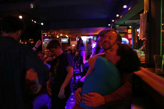 Minty Monday regulars dance to a karaoke song February 16, 2015 in San Francisco, Calif.