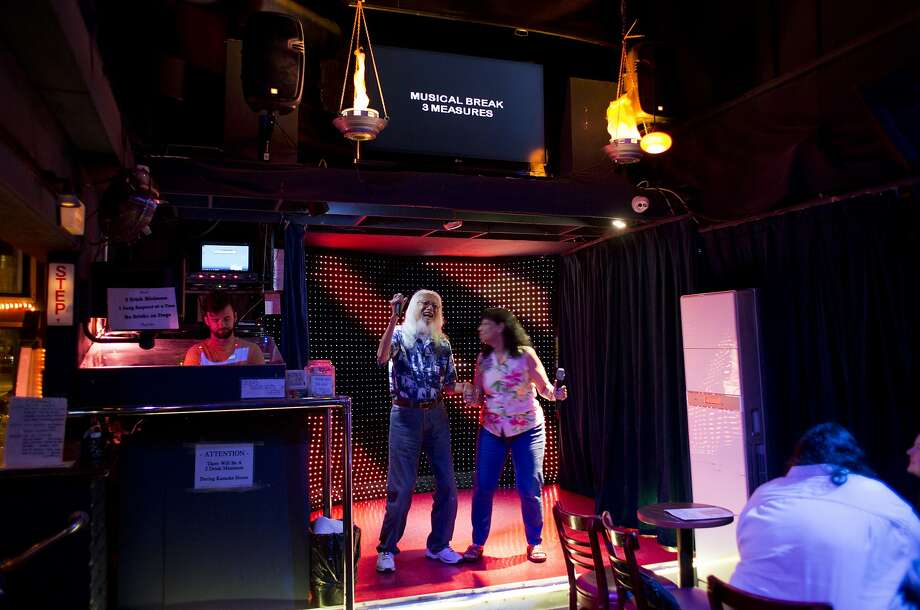 "Jones Chan, 96, and wife, Kathleen, sing ""I Got You Babe"" at karaoke at The Mint on Market Street August 31, 2015 in San Francisco, Calif. They sing the duet nearly every Monday night. ""I've done karaoke all over the world and this is the most friendly place,"" says Kathleen Chan. Photo: Erin Brethauer, The Chronicle"