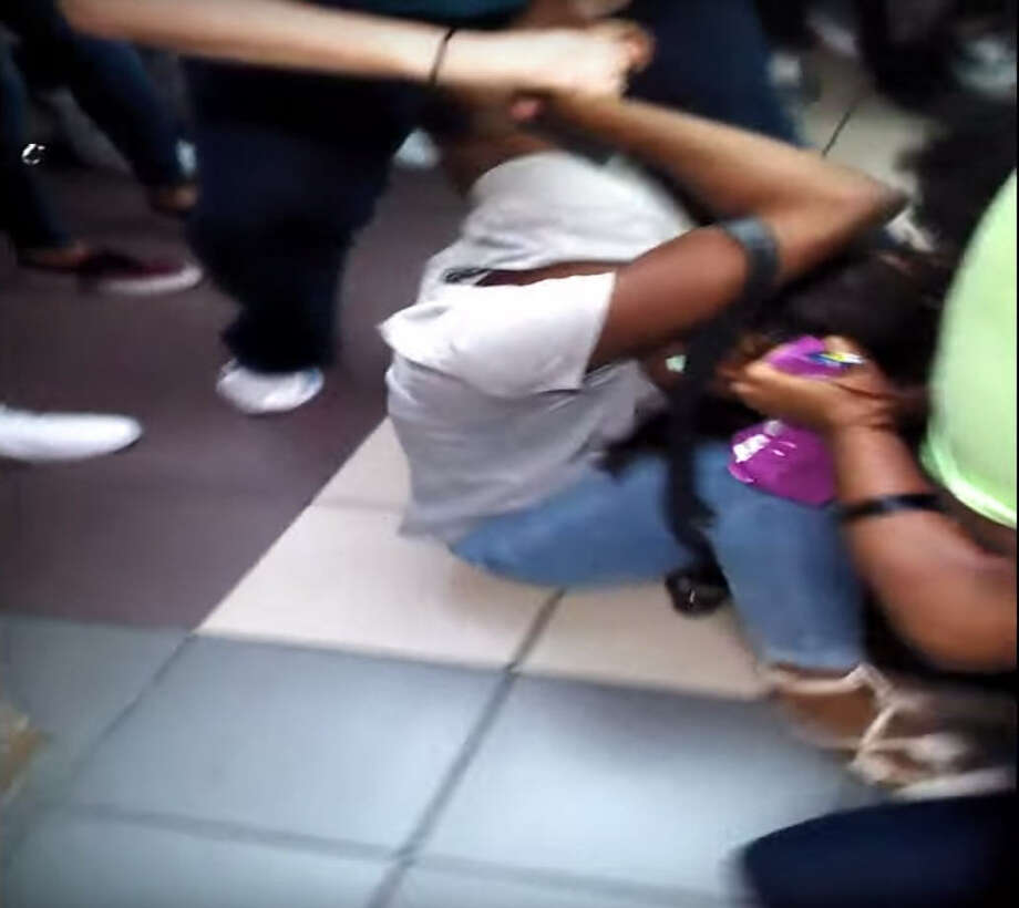 Video shows a vicious Houston high school brawl less than two weeks after the semester's start. Footage shot by a Cypress Lakes High School student bystander Monday quickly spread through social media. It shows a handful of girls pulling hair and clawing at clothing before they tumble to the ground and continue dealing blows. Photo: YouTube