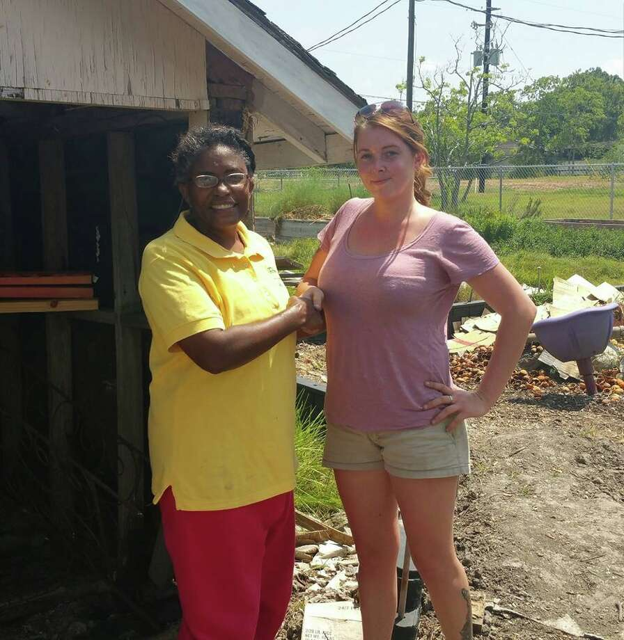 GardenKids project lead Sheila Thorne, left, and artist Danielle Vanwinkle prepare the organization's toolshed for its new mural. Photo: GardenKids Of Kemah