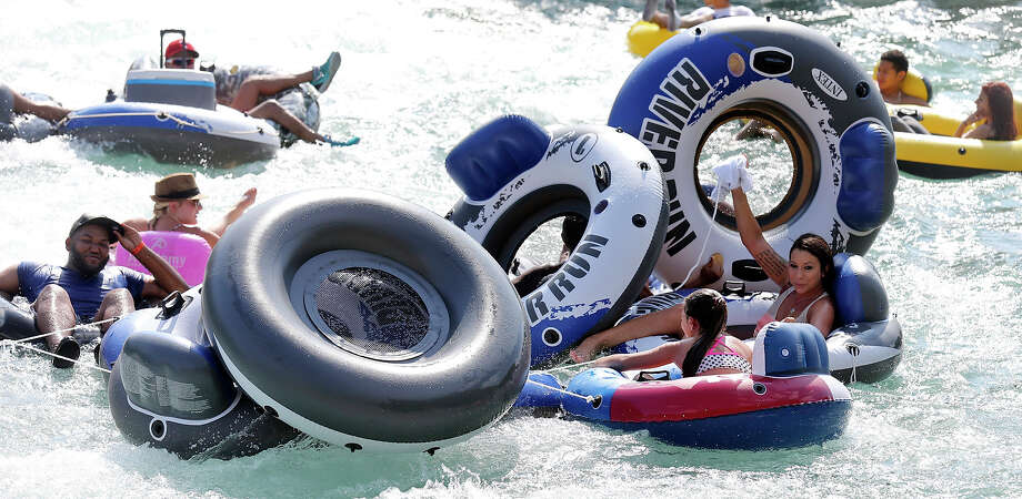 Trying to stay cool tubers enjoy the tube chute in Prince Solms Park on the Comal River Sunday July 26, 2015 in New Braunfels, Tx. Photo: Edward A. Ornelas, Staff / San Antonio Express-News / © 2015 San Antonio Express-News