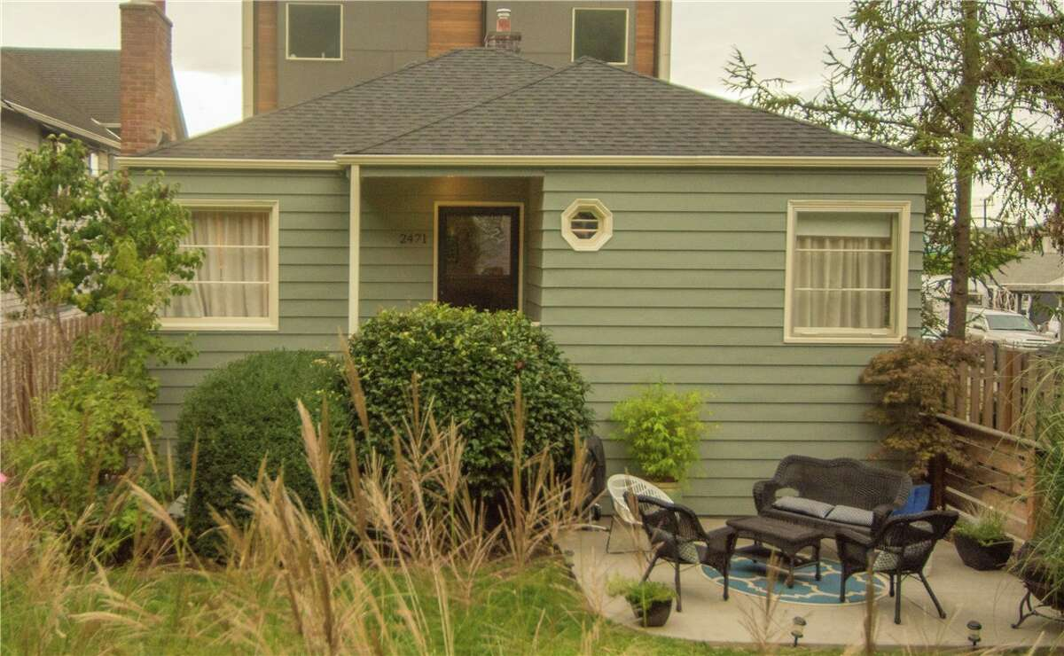 Exterior of 2471 55th Ave. SW in Alki, West Seattle. The home goes for $629,950. It has three bedrooms and 1.75 baths with 1,560 square feet and a full basement. This home's open house takes place from 1 to 4 p.m. Sunday.