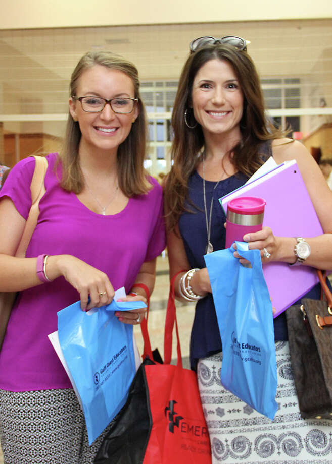 New Pearland ISD teachers pick up goody bags during the new teacher breakfast Aug. 11, co-sponsored by Gulf Coast Educators Federal Credit Union and American Federation of Teachers. Photo: Pearland ISD