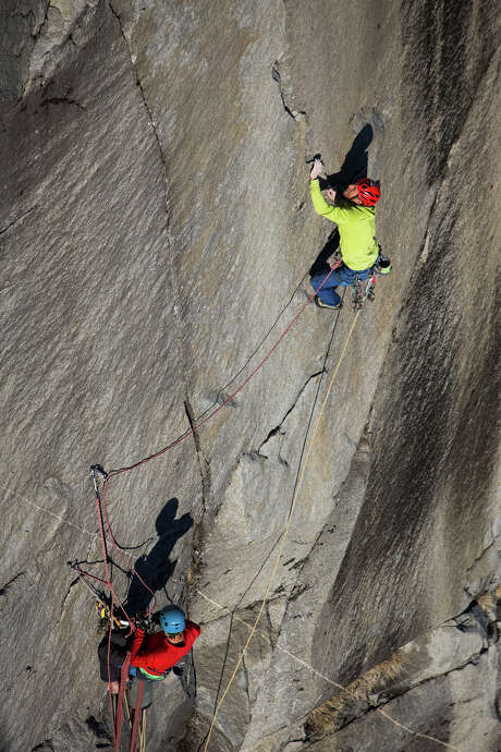Tommy Caldwell (top) ascends the final pitch of the Dawn Wall on El Capitan, belayed by his climbing partner, Kevin Jorgeson, in Yosemite National Park in January. Using ropes as a safety measure only, Caldwell and Jorgeson became the first to climb by hand the 3,000-foot granite wall, an ascent they began Dec. 27. Photo: MAX WHITTAKER / New York Times / NYTNS