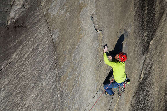 Tommy Caldwell, top, ascends the final pitch of the Dawn Wall on El Capitan, belayed by his climbing partner Kevin Jorgeson, below, in Yosemite National Park, Calif., Jan. 14, 2015. Using ropes as a safety measure only, Caldwell and Jorgeson became the first to climb by hand the 3,000-foot granite wall, an ascent they began on Dec. 27. (Max Whittaker/The New York Times)