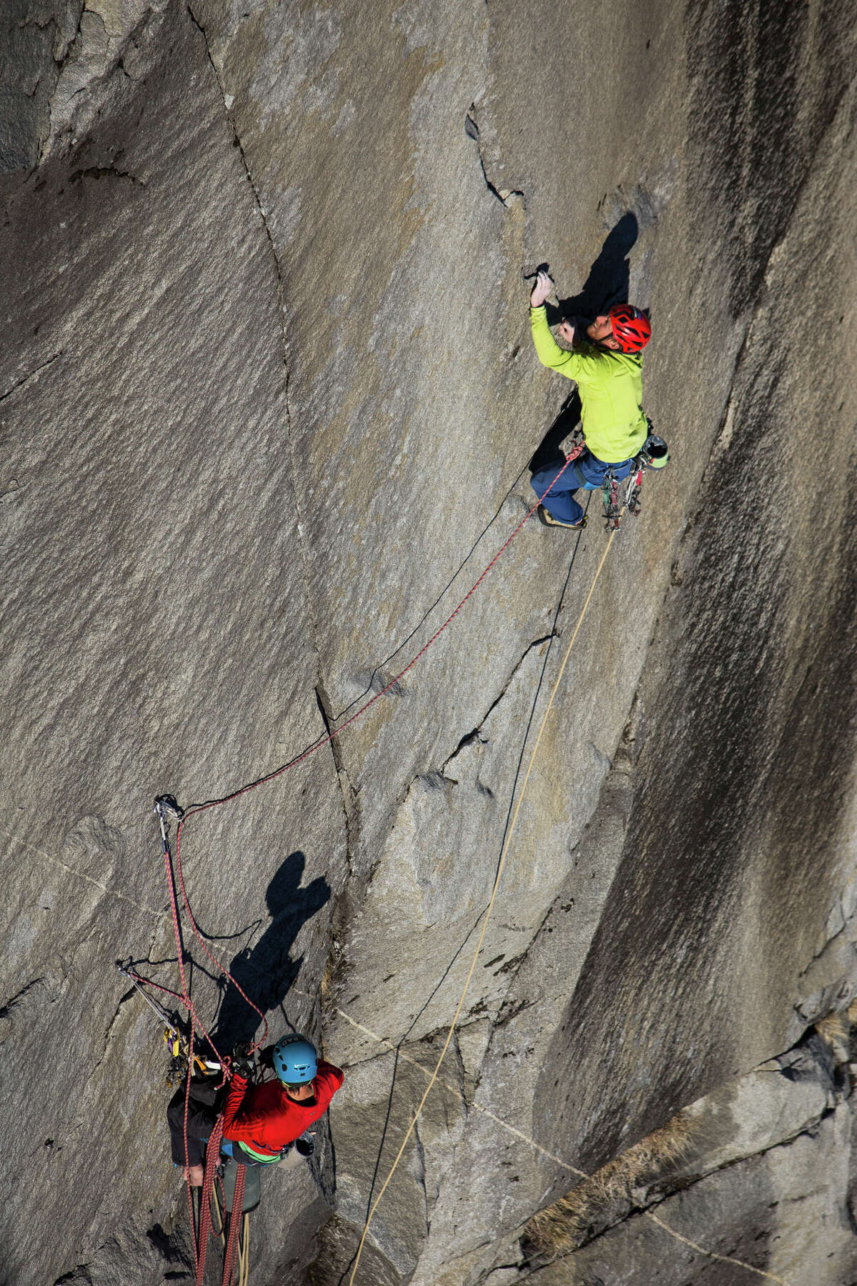 Tommy Caldwell (top) ascends the final pitch of the Dawn Wall on El Capitan, belayed by his climbing partner, Kevin Jorgeson, in Yosemite National Park in January. Using ropes as a safety measure only, Caldwell and Jorgeson became the first to climb by hand the 3,000-foot granite wall, an ascent they began Dec. 27.