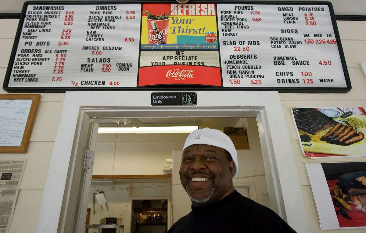 Pierson & Company Bar-B-Que restaurant owner Clarence Pierson suffered from a persistent cough and bad knees after so many years manning a barbecue pit. He is in better health now after making adjustments.