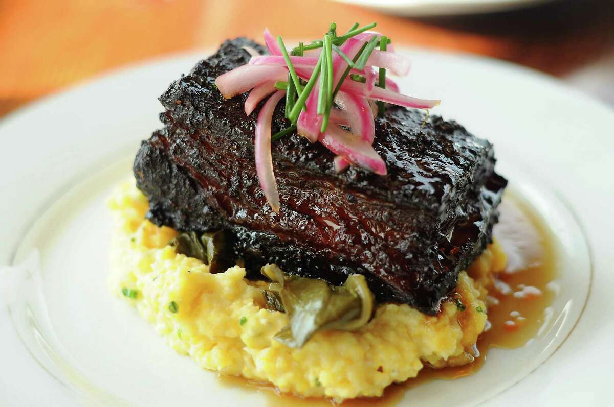 The beef belly burnt ends with cheese grits, braised greens and cane syrup at Southern Goods at 632 W. 19th St. Wednesday Sept. 2,2015.(Dave Rossman photo)
