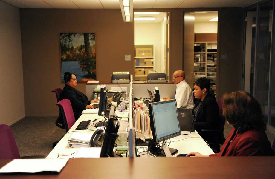 Deloitte employees at work in downtown Stamford, Conn. in January 2015. The consulting firm is among the local companies that have made efforts to accommodate employees through flex-time, allowing it to use less office space than Deloitte might otherwise need to house a local workforce it lists at 1,300 people. Photo: Tyler Sizemore / Hearst Connecticut Media / Greenwich Time