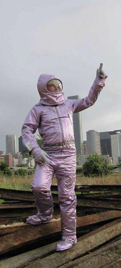 Houston artist Nance wears his award-winning pink spacesuit costume in an image that will appear this fall on signs near the Hilton-Americas Houston and Toyota Center. Photo: Courtesy Of The Artist