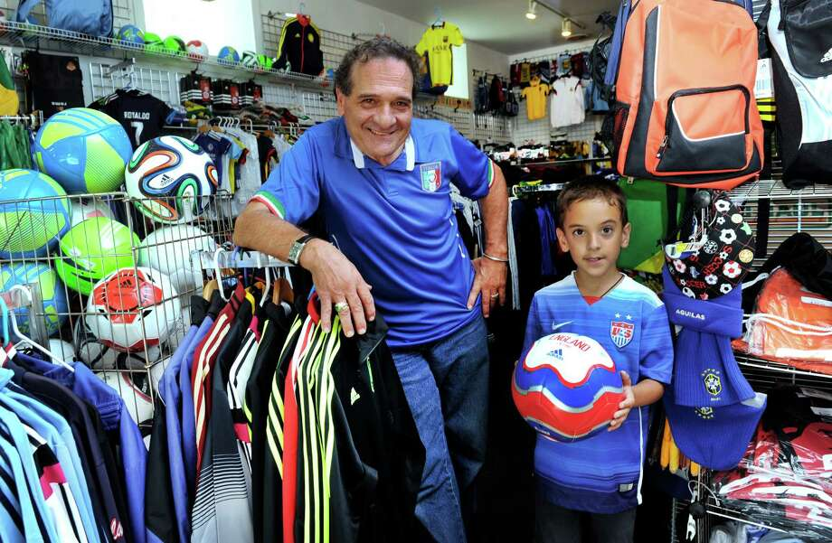 Tony DiPreta with a young customer, Ricky Redrovan, 7, has opened up a new store on West Wooster Street in Danbury called American Pro Soccer Supply. Photo Thursday, Sept. 3, 2015. Photo: Carol Kaliff / Hearst Connecticut Media / The News-Times