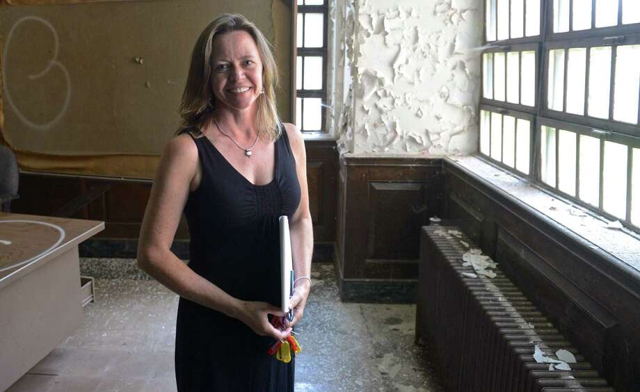 Newtown Grants Coordinator Christal Prezler stands inside Canaan House, a 220,000-square foot building on the Fairfield Hills Campus that is planned for demolition later this month. Wednesday, September 2, 2015, in Newtown, Conn. Photo: H John Voorhees III / Hearst Connecticut Media / The News-Times