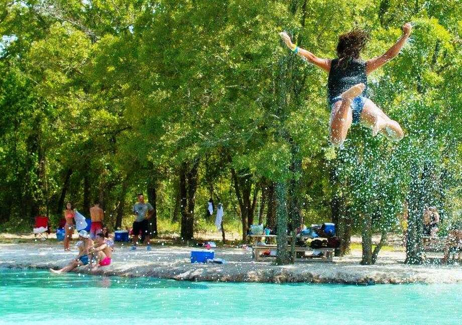 Some riders on the Royal Flush waterslides at BSR Cable Park in Waco spin and turn and flip Louganis-like while in mid-air. Water quality test results came back this week.