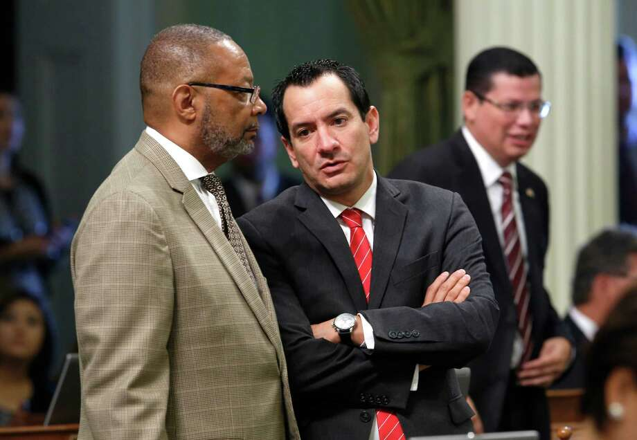 In this photo taken Wednesday Sept. 2, 2015,  Assemblyman Reginald Jones-Sawyer, Sr, D-Los Angeles, left, talks with Assembly Anthony Rendon, D-Lakewood, at the Capitol in Sacramento,Calif. Photo: Rich Pedroncelli / Associated Press / AP