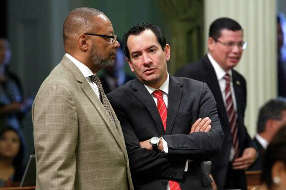 In this photo taken Wednesday Sept. 2, 2015,  Assemblyman Reginald Jones-Sawyer, Sr, D-Los Angeles, left, talks with Assembly Anthony Rendon, D-Lakewood, at the Capitol in Sacramento,Calif.  The Democratic caucus has voted, Thursday, for Rendon to become the 70th Assembly Speaker.  Rendon will take over from current Speaker,Toni Atkins, D-San Diego,  after a floor vote in January and a transition period to be determined by the Speaker and Speaker-elect. (AP Photo/Rich Pedroncelli)