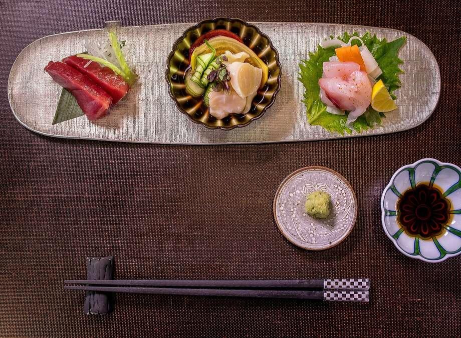 Akami (left), aoyagi, medai sashimi at Omakase in S.F. Photo: John Storey, Special To The Chronicle
