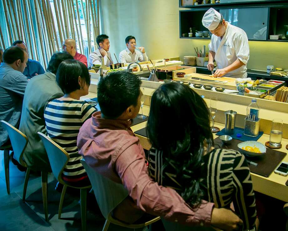 The 14-seat counter at tiny Omakase allows the chefs to converse with diners. Photo: John Storey, Special To The Chronicle